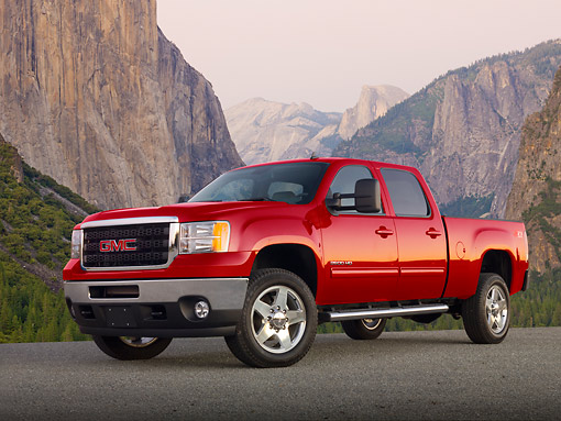 AUT 14 BK0084 01 © Kimball Stock 2012 GMC Sierra Pickup Truck Red 3/4 Front View On Pavement By Mountains