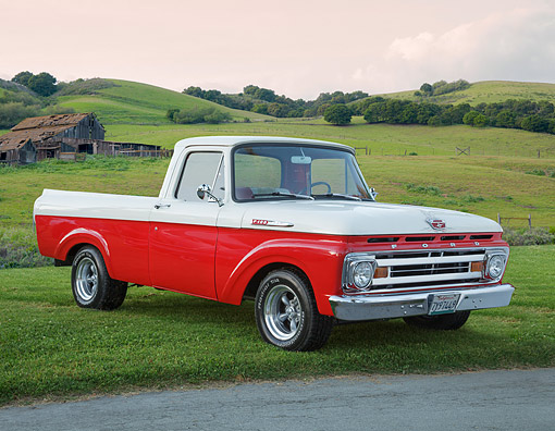 AUT 14 BK0085 01 © Kimball Stock 1961 Ford F-100 Pickup Red And White 3/4 Front View On Grass By Old Wooden Barn