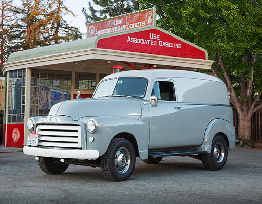 AUT 14 BK0086 01 © Kimball Stock 1953 GMC Panel Truck Gray 3/4 Front View On Pavement By Gas Station