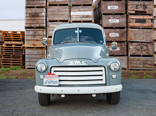 AUT 14 BK0087 01 © Kimball Stock 1953 GMC Panel Truck Gray Front View On Pavement By Wooden Crates