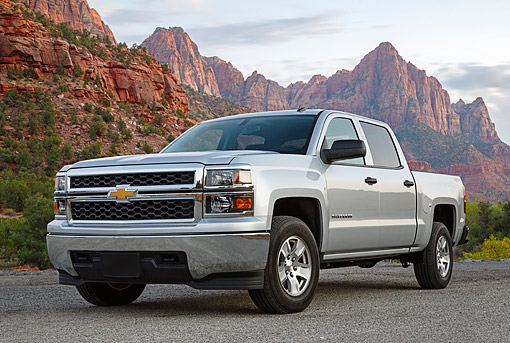 AUT 14 BK0090 01 © Kimball Stock 2014 Chevrolet Silverado Pickup Silver 3/4 Front View On Gravel By Red Rock