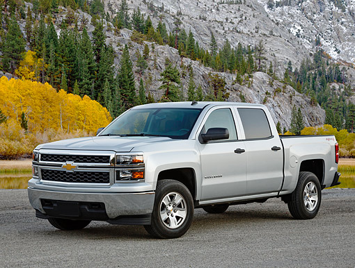 AUT 14 BK0092 01 © Kimball Stock 2014 Chevrolet Silverado Pickup Silver 3/4 Front View On Gravel By Mountain