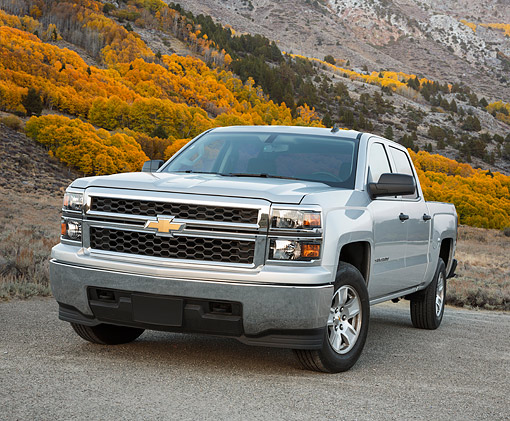 AUT 14 BK0093 01 © Kimball Stock 2014 Chevrolet Silverado Pickup Silver 3/4 Front View On Gravel By Mountain