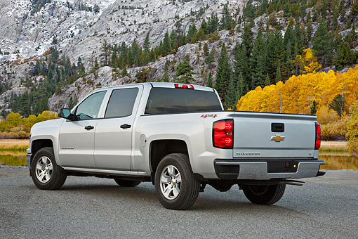 AUT 14 BK0094 01 © Kimball Stock 2014 Chevrolet Silverado Pickup Silver 3/4 Rear View On Gravel By Mountain