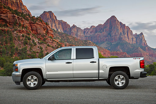 AUT 14 BK0096 01 © Kimball Stock 2014 Chevrolet Silverado Pickup Silver Profile View On Gravel By Red Rock