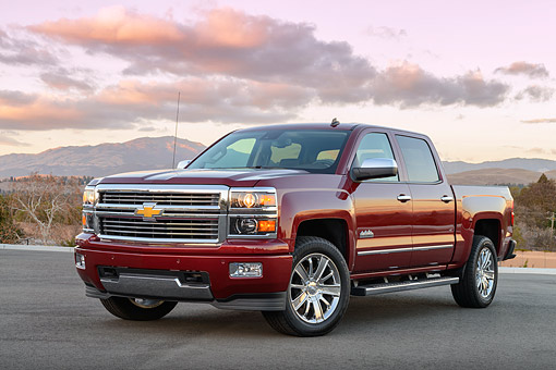 AUT 14 BK0097 01 © Kimball Stock 2014 Chevrolet Silverado Pickup Red 3/4 Front View On Pavement By Mountains At Sunrise