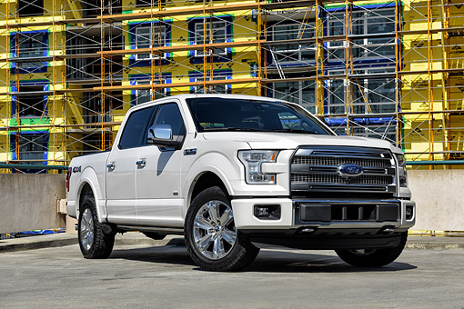 AUT 14 BK0110 01 © Kimball Stock 2015 Ford F-150 Platinum 4x4 White 3/4 Front View By Construction Site
