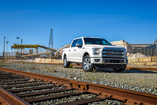 AUT 14 BK0113 01 © Kimball Stock 2015 Ford F-150 Platinum 4x4 White 3/4 Front View By Train Tracks
