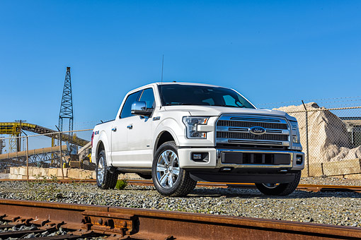 AUT 14 BK0114 01 © Kimball Stock 2015 Ford F-150 Platinum 4x4 White 3/4 Front View By Train Tracks