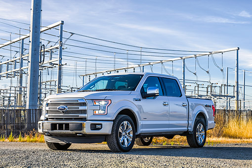 AUT 14 BK0115 01 © Kimball Stock 2015 Ford F-150 Platinum 4x4 White 3/4 Front View By Power Lines