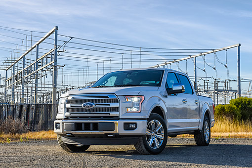 AUT 14 BK0116 01 © Kimball Stock 2015 Ford F-150 Platinum 4x4 White 3/4 Front View By Power Lines