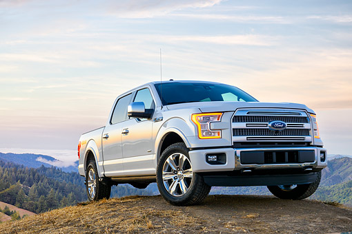 AUT 14 BK0118 01 © Kimball Stock 2015 Ford F-150 Platinum 4x4 White 3/4 Front View By Grass And Hills