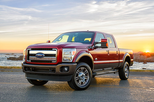 AUT 14 BK0121 01 © Kimball Stock 2015 Ford Super Duty F-350 Lariat Pickup Red 3/4 Front View By Ocean