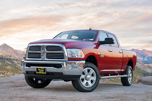 AUT 14 BK0127 01 © Kimball Stock 2016 Dodge Ram 3500 Heavy Duty Hemi 6.4 Liter Red 3/4 Front View By Trees And Mountains