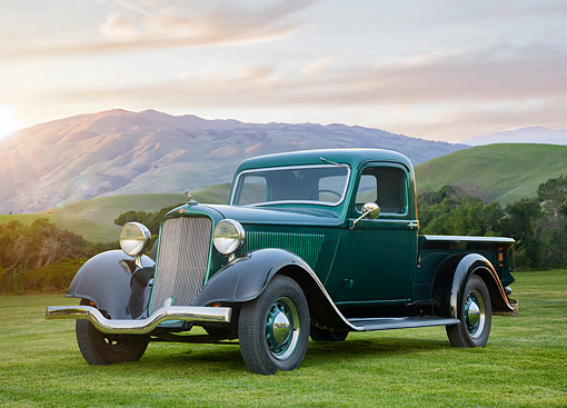 AUT 14 BK0137 01 © Kimball Stock 1935 Dodge KCL Pickup Green 3/4 Front View By Hills At Sunset