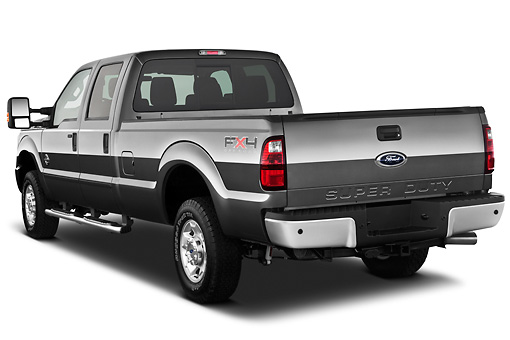 AUT 14 IZ0128 01 © Kimball Stock 2013 Ford F-250 SD Crew Cab 4X4 Pickup Truck Silver 3/4 Rear View On White Seamless