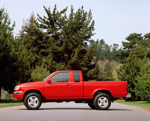 AUT 14 RK0057 04 © Kimball Stock 2000 Nissan Frontier Desert Runner Pick Up Truck Red Profile On Pavement Trees Background