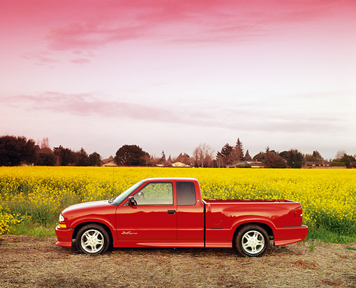 AUT 14 RK0074 04 © Kimball Stock 1999 Chevrolet S-10 Extreme Pick Up Truck Red Profile In Yellow Flower Field At Dusk