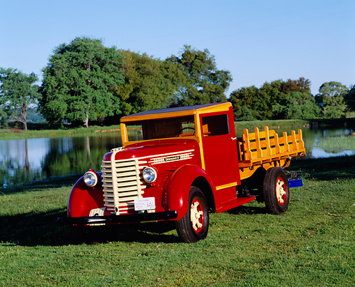 AUT 14 RK0087 08 © Kimball Stock 1942 Diamond T Model 201 Truck 3/4 Front View On Grass By Water And Trees Blue Sky