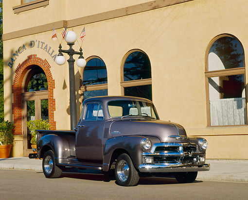 AUT 14 RK0103 02 © Kimball Stock 1954 Chevrolet 3100 Truck Century Gray 3/4 Front View On Pavement By Building