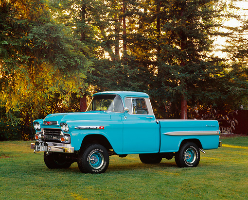 AUT 14 RK0121 02 © Kimball Stock 1959 Chevrolet Apache Pickup Truck Aqua 3/4 Side View On Grass By Trees