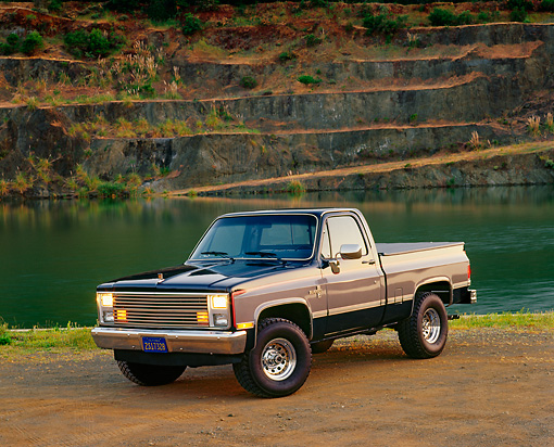 AUT 14 RK0145 03 © Kimball Stock 1986 Chevrolet Silverado 1/2 Ton 4x4 Truck 3/4 Side View On Dirt By Water