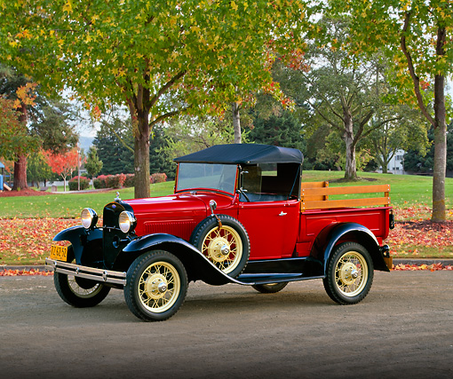 AUT 14 RK0418 04 © Kimball Stock 1930 Model A Ford Roadster Pick Up Truck 3/4 Side View On Pavement By Autumn Trees