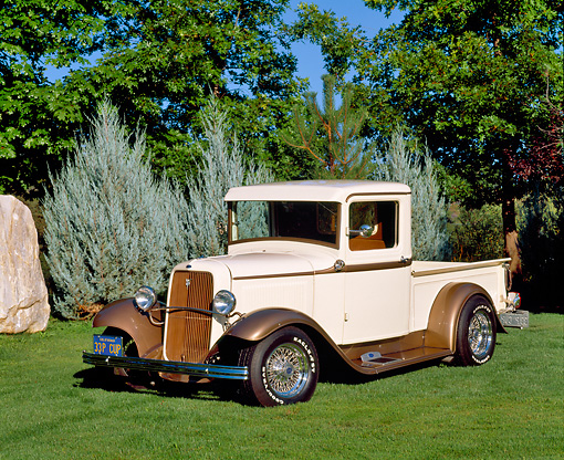 AUT 14 RK0436 03 © Kimball Stock 1933 Ford Pickup Truck Cream And Light Brown 3/4 Front View On Grass