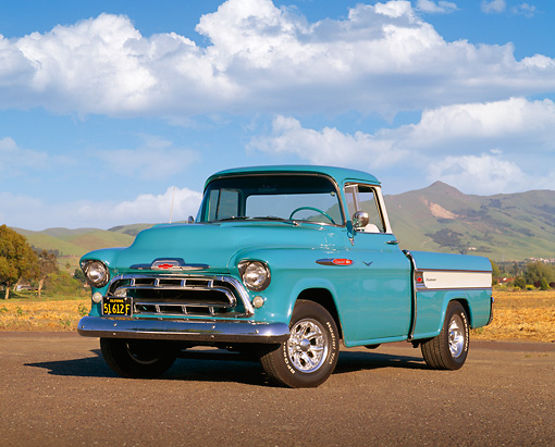AUT 14 RK0494 03 © Kimball Stock 1957 Chevy Cameo Pick Up Truck Blue 3/4 Front View On Pavement By Hills