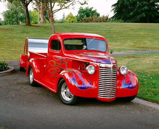 AUT 14 RK0497 01 © Kimball Stock 1940 Chevy 1/2 Ton Pick Up Red With Blue Flames 3/4 Front 1946 Teardrop Trailer