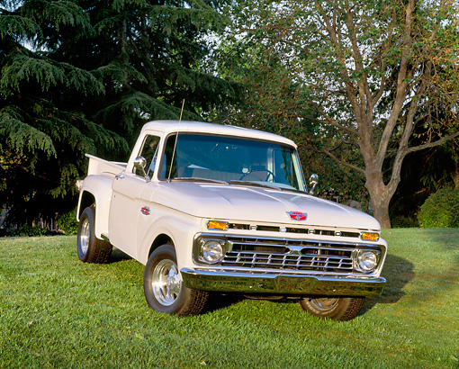 AUT 14 RK0506 06 © Kimball Stock 1965 Ford F-100 Pick Up Truck White 3/4 Front View On Grass By Trees