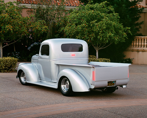 AUT 14 RK0635 01 © Kimball Stock 1946 Chevy 1/2 Ton Silver Rear 3/4 View On Pavement By Trees