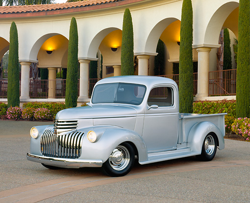 AUT 14 RK0637 01 © Kimball Stock 1946 Chevy 1/2 Ton Silver Front 3/4 View On Pavement By Building And Trees