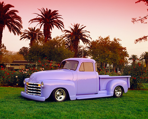 AUT 14 RK0655 02 © Kimball Stock 1950 Chevy Pickup Truck Periwinkle 3/4 Side View On Grass By Trees Filtered