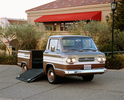 AUT 14 RK0656 07 © Kimball Stock 1964 Chevrolet Corvair 95 Rampside Tan And White 3/4 Front View On Pavement By Building