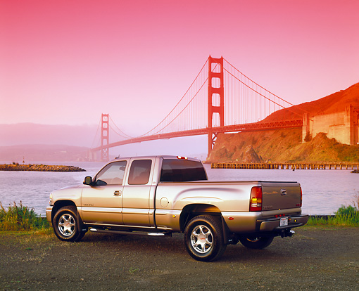 AUT 14 RK0671 04 © Kimball Stock 2002 GMC Sierra Denali AWD 4 Door Pewter 3/4 Rear View By SF Bridge