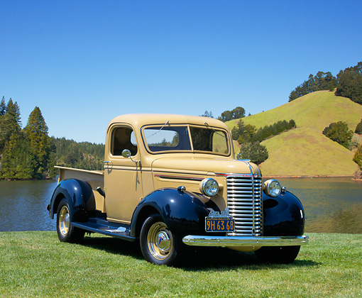 AUT 14 RK0674 04 © Kimball Stock 1939 Chevrolet Pickup Truck Tan And Blue 3/4 Front View On Grass By Water