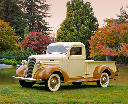 AUT 14 RK0677 01 © Kimball Stock 1937 Chevrolet 1/2 Ton Pickup Truck Beige And Brown Side 3/4 Side View On Grass By Water And Autumn Trees