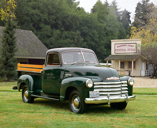 AUT 14 RK0682 02 © Kimball Stock 1950 Chevrolet 3100 Deluxe Pickup Truck Black 3/4 Front View On Grass By General Store