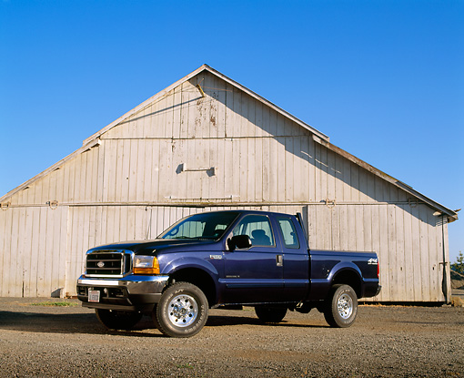 AUT 14 RK0715 07 © Kimball Stock 2001 Ford F-250 Blue 3/4 Front View On Gravel By Barn