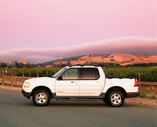 AUT 14 RK0718 05 © Kimball Stock 2002 Ford Explorer Sport Trac White Profile On Pavement By Vineyard Filtered