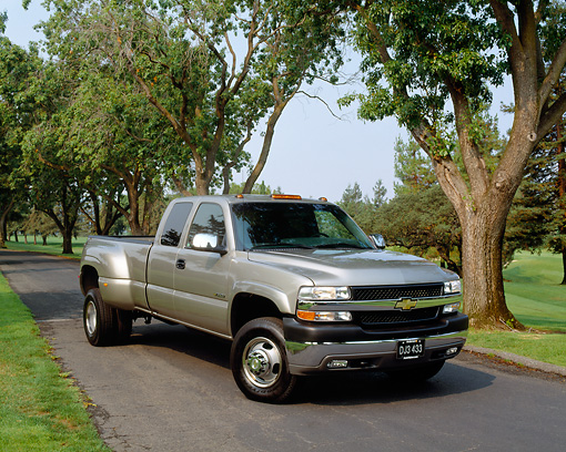 AUT 14 RK0736 04 © Kimball Stock 2002 Chevy 3500 Dually Pick Up Pewter 3/4 Front View On Pavement By Trees And Grass