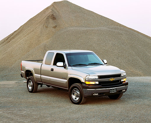 AUT 14 RK0767 02 © Kimball Stock 2002 Chevy Silverado LS 2500HD 4WD Crew Pick Up Truck Pewter 3/4 Front View By Gravel Mound