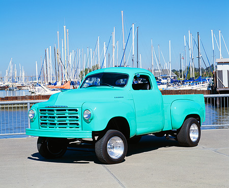 AUT 14 RK0784 03 © Kimball Stock 1952 Studebaker Pick Up Truck Turquoise 3/4 Front View On Pavement By Harbor