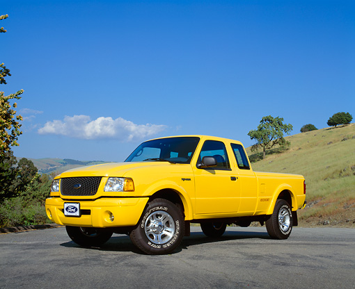 AUT 14 RK0916 01 © Kimball Stock 2003 Ford Ranger Super Cab Edge Yellow Low 3/4 Front View On Pavement