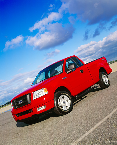 AUT 14 RK0927 03 © Kimball Stock 2004 Ford F-150 STX Red Slanted 3/4 Front View On Pavement Cloudy Blue Sky