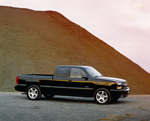 AUT 14 RK0944 02 © Kimball Stock 2003 Chevy Silverado SS 1500 Black 3/4 Side View By Dirt Pile Filtered