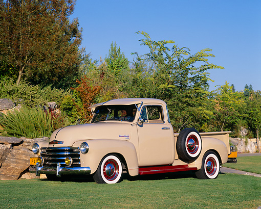 AUT 14 RK0953 03 © Kimball Stock 1949 Chevy Pick Up Truck Tan 3/4 Side View On Grass By Bushes