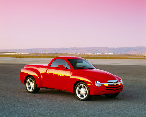 AUT 14 RK0965 01 © Kimball Stock 2003 Chevrolet SSR Convertible Red Truck 3/4 Front View On Pavement Filtered