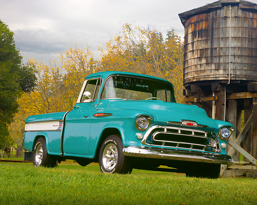 AUT 14 RK0998 01 © Kimball Stock 1957 Chevy Cameo Pick Up Truck Turquoise 3/4 Front View On Grass By Watershed